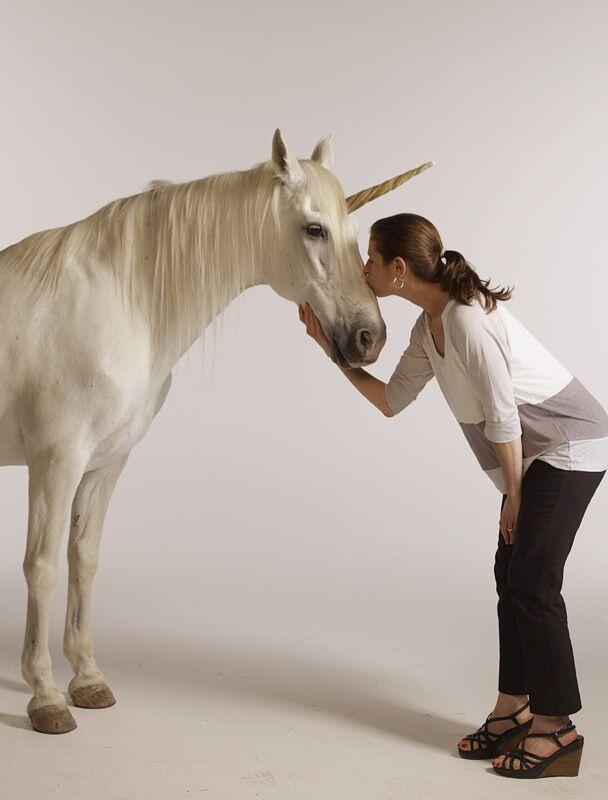 Karen Frank kisses a unicorn