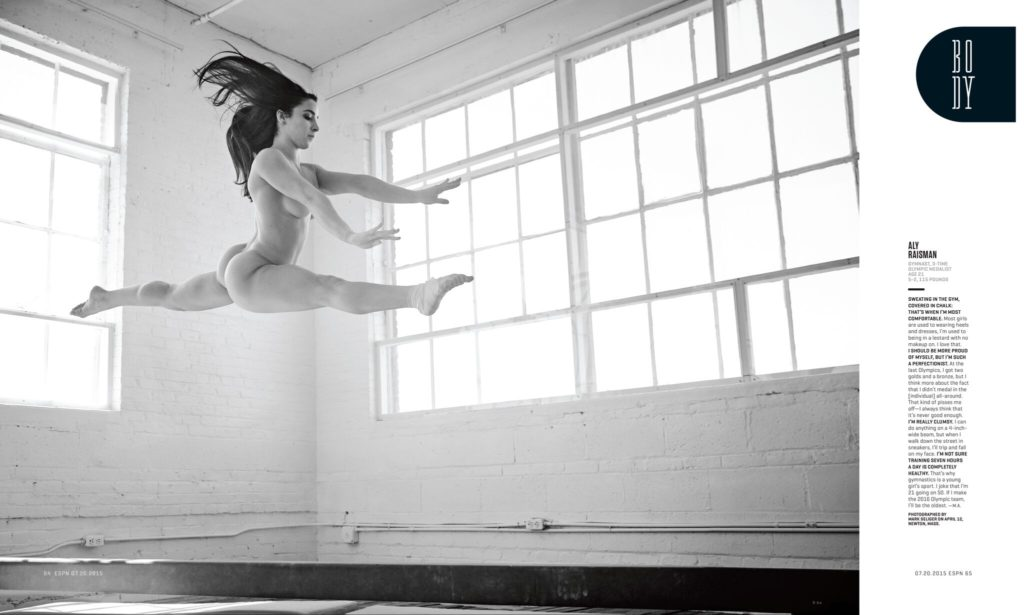 Black and white photo of Aly Raisman leaping in air